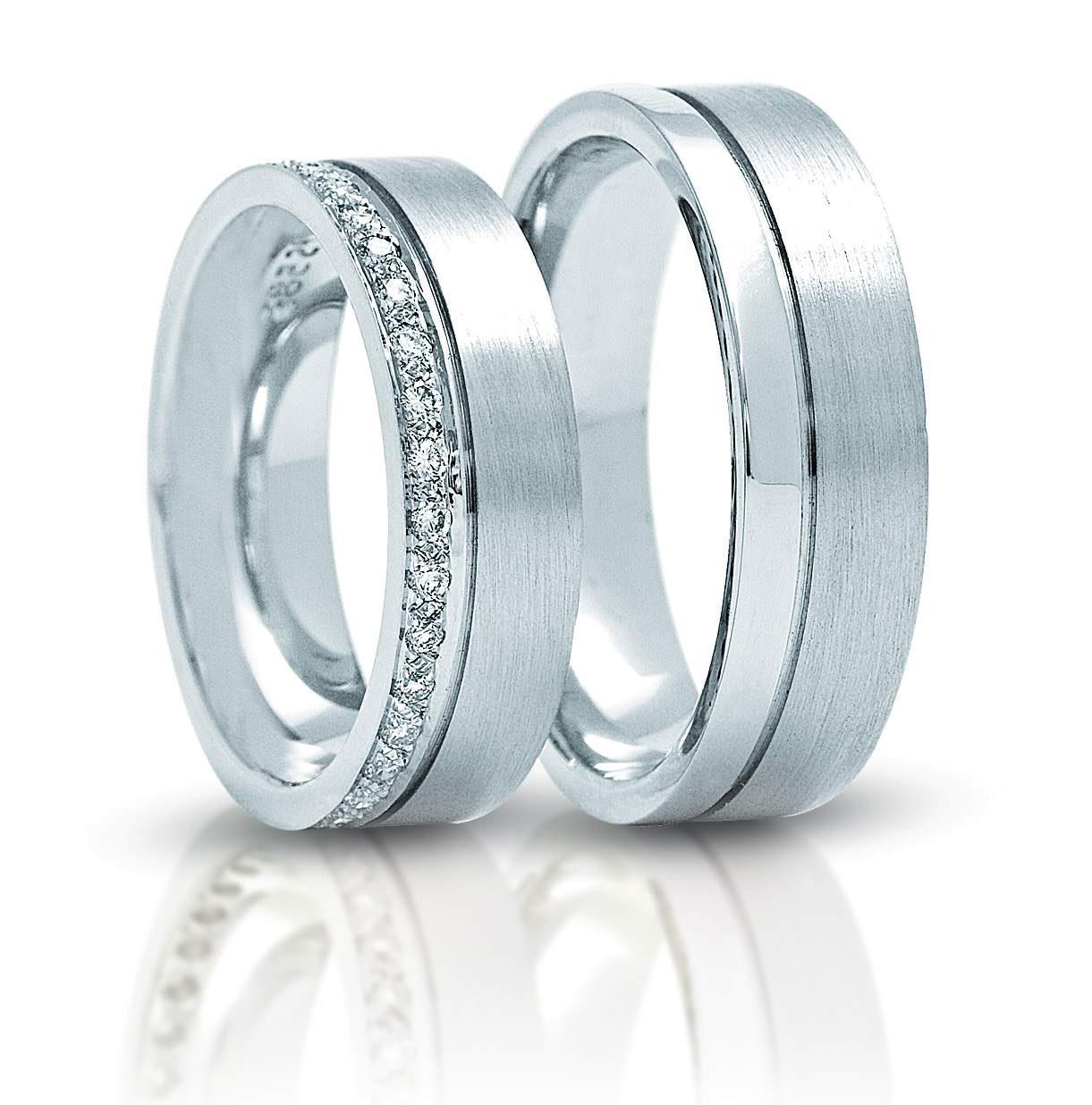 Обручальные кольца парные из белого золота 585