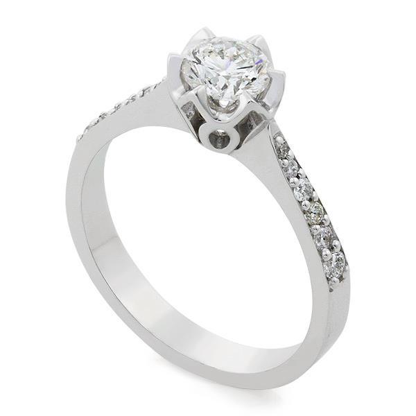 Помолвочное кольцо с 1 бриллиантом 0,64 ct 3/6 и 12 бриллиантами 0,16 ct 3/4 белое золото 750°